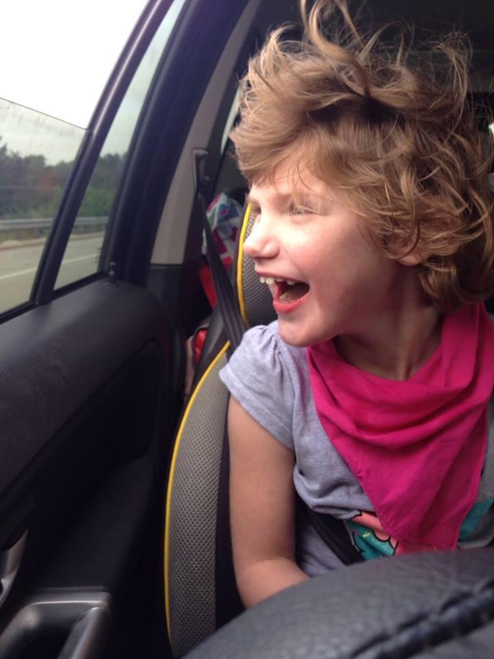eliza in the car